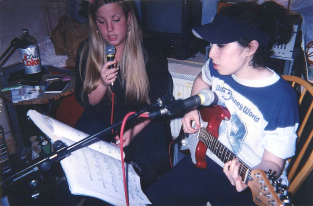 Amy Winehouse playing guitar with Juliette Ashby as teenagers. AMY directed by Asif Kapadia, in cinemas July 2 2015. An Entertainment One Films release.