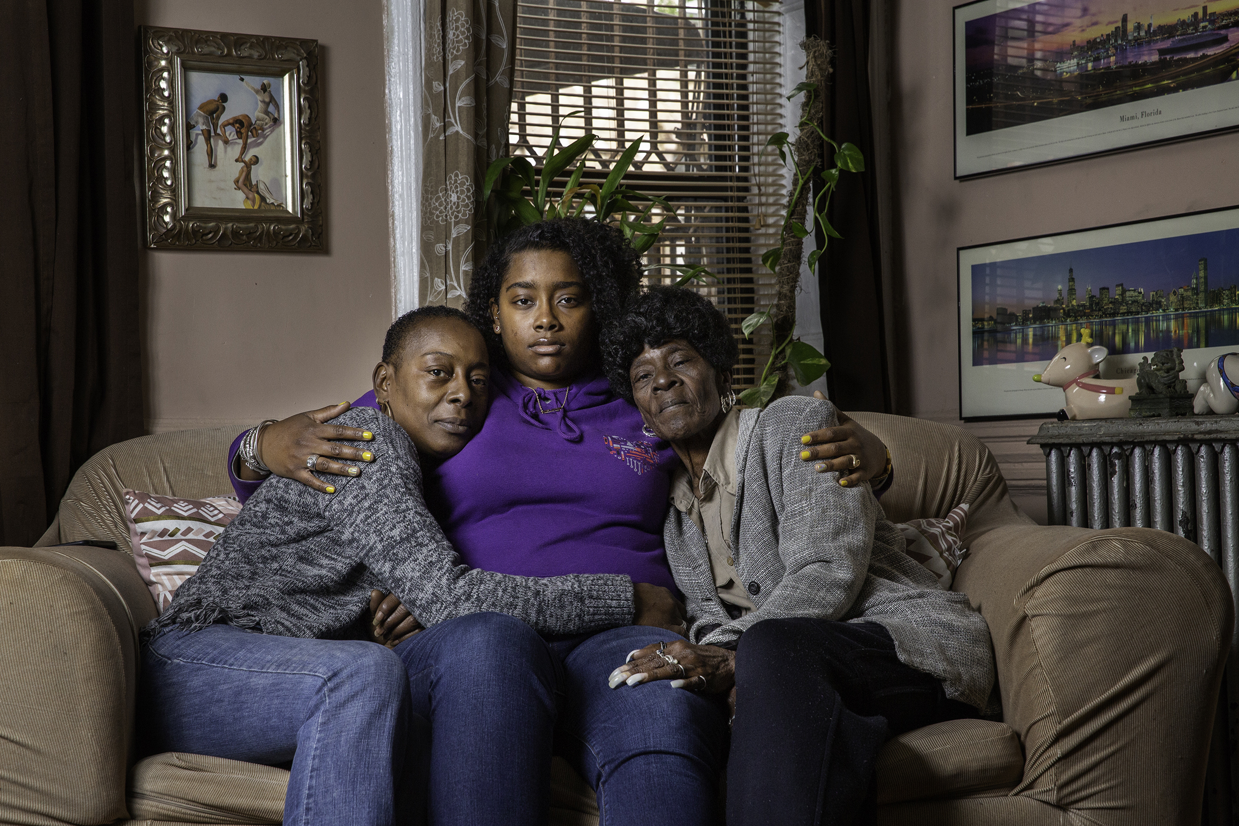 Taji M. Riley with her mother, Mary L. Johnson (left) and grandmother, Mary L. Johnson (right) at their home in Bronx, New York on April 27.